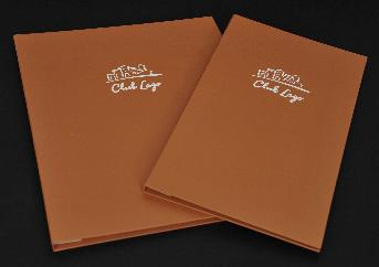 Food menu, orange cover, white logo.